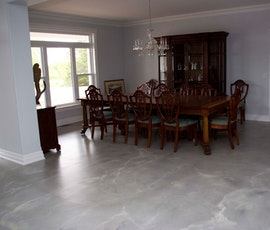 Resurfaced concrete makes this dining room have a trendy appearance (thumbnail)