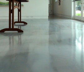 This photo illustrates the high-gloss and deep color of Duraamen's metallic epoxy flooring. (thumbnail)