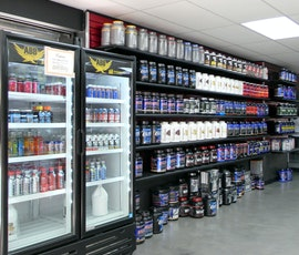 A resurfaced concrete floor is low maintenance and resists spills, perfect for a retailer who sells food products such as this fitness store. (thumbnail)
