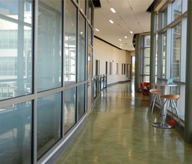 The subtle and beautiful textures and colors of the newly resurfaced concrete flooring compliments the glass panel walls at Southern Connecticut State University (SCSU). (thumbnail)