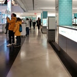 """People shopping in the Tiffany & Co. """"pop-up"""" store in NYC. Polished concrete floors with Duraamen products."""