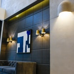 Residential building lobby, Brooklyn, NY: Tasteful interior design, concrete walls with blue art hung.