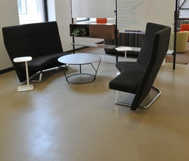 Another casual workspace that features an earth toned, modern looking concrete floor from Duraamen. (thumbnail)
