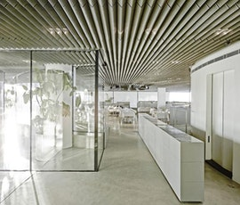 Glass and concrete are two of the contemporary materials used to create the ultra-modern restaurant, Stereokitchen. The flooring is a concrete overlay from Duraamen. (thumbnail)