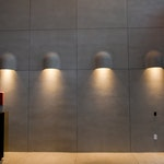 Residential building lobby, Brooklyn, NY: Minimalist interior design, concrete walls with beautiful scone lighting.