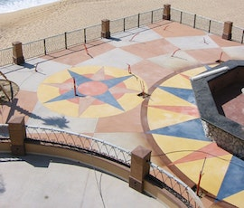 The view of the ocean and the decorative exterior concrete patio at this Mexican resort is spectacular. (thumbnail)