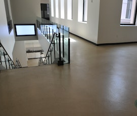 The natural light highlights the expansive concrete floors.  (thumbnail)
