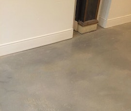 A detail photo of the new self-leveling concrete floor in this contemporary shared office space. (thumbnail)