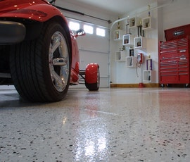 This hot rod garage has a high shine flooring thanks to Duraamen's epoxy resin chip system. (thumbnail)