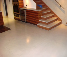 The modern look of this residence's floor was created with a concrete overlay microtopping. (thumbnail)