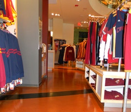 Another view of merchandise reflecting off the metallic epoxy floor in the Cleveland Cavaliers Team Shop. (thumbnail)