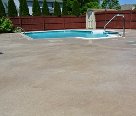 This large concrete patio near the pool has been resurfaced with Uberdek, a concrete resurfacing product from Duraamen. (thumbnail)