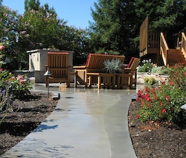 This garden walkway is decorated with an organic curve and two shades of gray. It is a concrete overlay from Duraamen. (thumbnail)