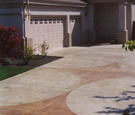 Concrete overlays can be colored and shapes or designs applied to add interest to an otherwise ordinary driveway.  (thumbnail)