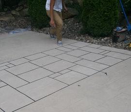 Decorative patio concrete with unique grid-like patterns using Uberdek.  (thumbnail)