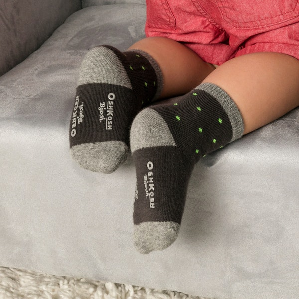 child with toddler boys socks