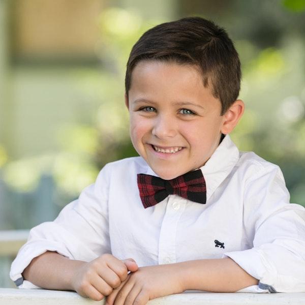 child with belts/suspenders/ties