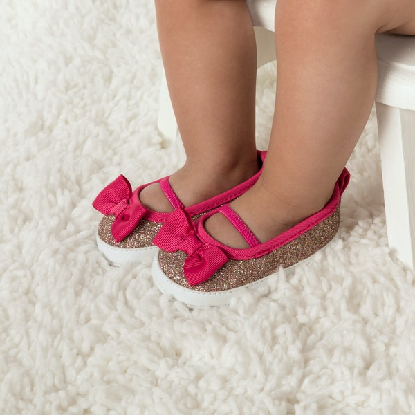 child with infant girl shoes
