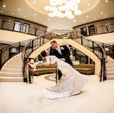The Main Entrance with Grand Marble Staircase and Waterfall Accents