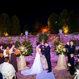 The Majestica Patio set for a night time outdoor Wedding Ceremony
